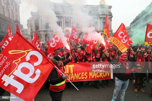 People hold a banner reading quotwithdrawal of Macron's executive ordersquot during a demonstration called by French General Confederation of Labour...