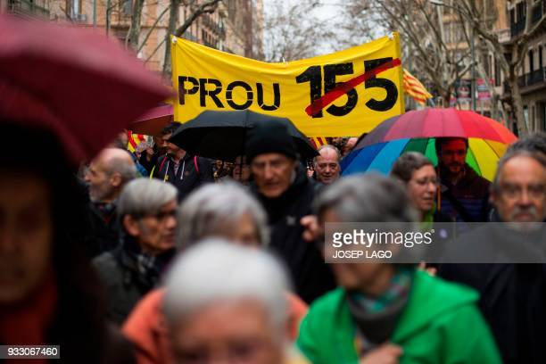 People hold a banner reading 'Stop 155' during a demonstration titled 'The democratic and cohesive school is not afraid' organized by Catalan...