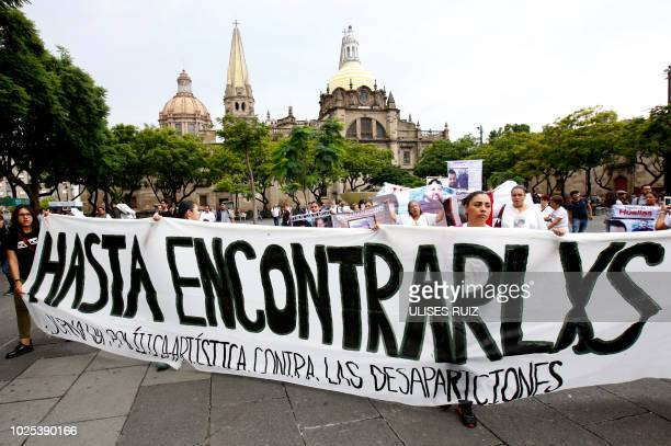 People hold a banner reading Till We Find Them during a protest on International Day of the Disappeared in Guadalajara Mexico in Mexico City on...