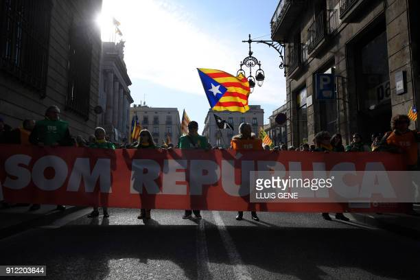 People hold a banner reading 'We are a republic' during a demonstration on January 30 2018 in Barcelona The speaker of Catalonia's parliament Roger...