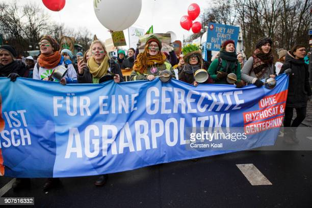 People hold a banner with the written slogan 'For a fair agriculture policy' during a demonstration against the agroindustry on January 20 2018 in...