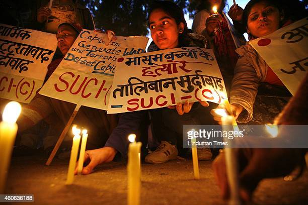 People hold a candlelight vigil for the victims of the Peshawar School attack at Jantar Mantar on December 18 2014 in New Delhi India The Pakistani...