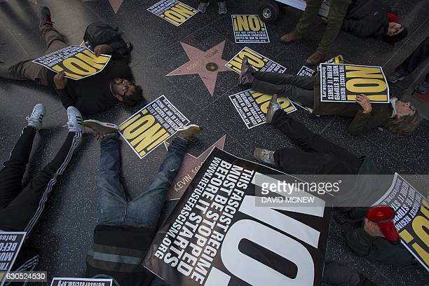 People hold a diein protest at the Hollywood Walk of Fame star for Donald Trump on Christmas Day in reaction against a Twitter post by US...