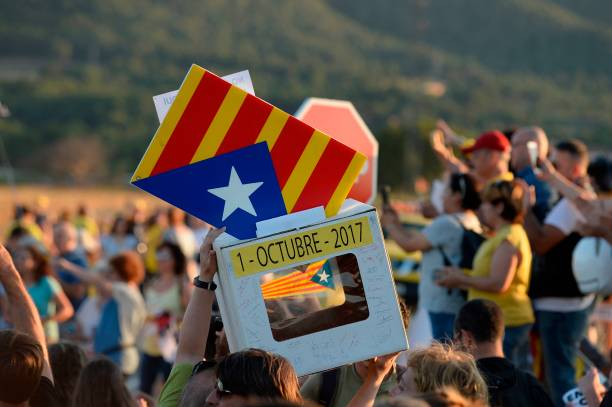 People hold a fake ballot box during a demonstration outside the