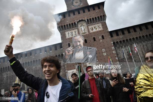 People hold a photograph representing Matteo Salvini as a mafia godfather as they take part in a demonstration by antiracism antifascist groups to...