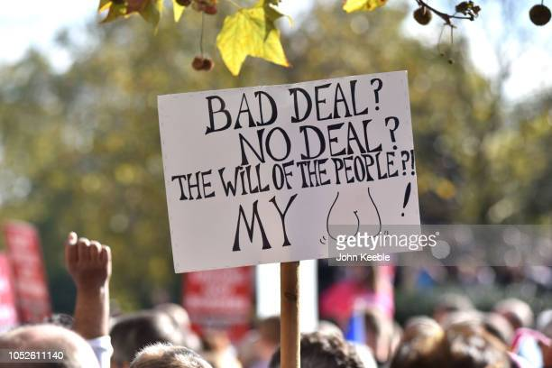 People hold a placard sauing Bad deal no deal the will of the people my and march to demand a people's vote against Brexit on October 20 2018 in...
