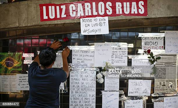 People hold a protest against homophobia at Dom Pedro II station in Sao Paulo Brazil on December 30 after street vendor Luiz Carlos Ruas was beaten...