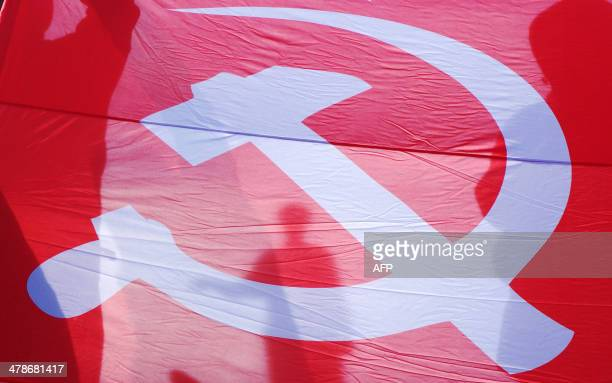 People hold a Soviet flag as they take part in a pro-Russian rally in the Black Sea Ukrainian city of Odessa on March 14, 2014. The United States and...