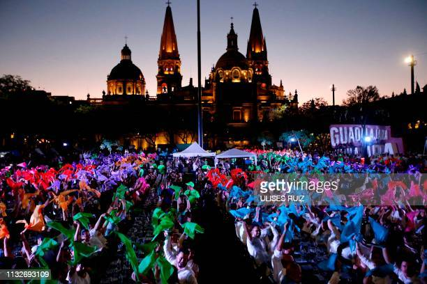 People hold a tequila tasting at the Plaza Liberacion in Guadalajara, Jalisco, Mexico, on March 24, 2019 in an attempt to set a new Guinness World...