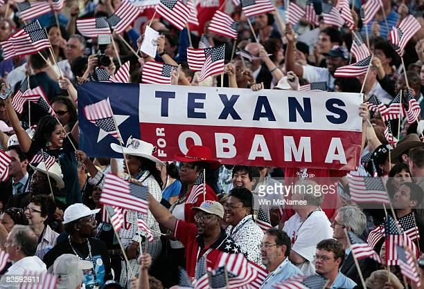 People hold a Texans for Obama sign on day four of the Democratic National Convention at Invesco Field at Mile High August 28 2008 in Denver Colorado...