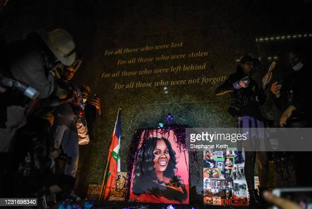 People hold a vigil at the African Burial Ground National Monument in a protest to mark the one year anniversary of Breonna Taylor's death on March...