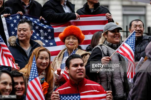 People hold american flags as they attend a protest in support of immigration in herald Square on February 10 2018 in New York / AFP PHOTO / KENA...