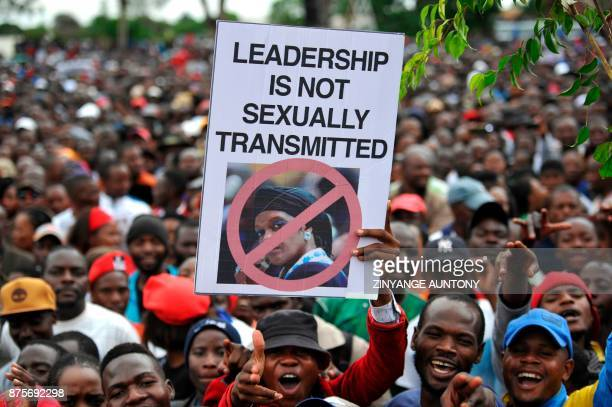 TOPSHOT People hold an antiGrace Mugabe placard during a demonstration demanding the resignation of Zimbabwe's president on November 18 2017 in...