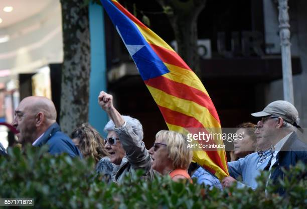 People hold an Catalan proindependence 'Estelada' flag during a demonstration called by Basque unions supporting the strike in Catalonia in the...
