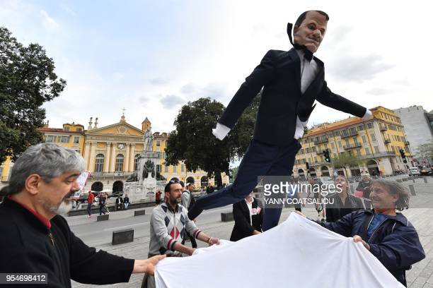 People hold an effigy of French President Emanuel Macron a local carnival tradition in Nice southern France on May 4 on the eve of a national rally...