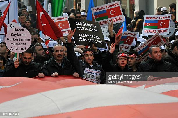 People hold antiArmenian banners as they demonstrate in Istanbul's central Taksim square on February 26 to commemorate the 20th anniversary of the...