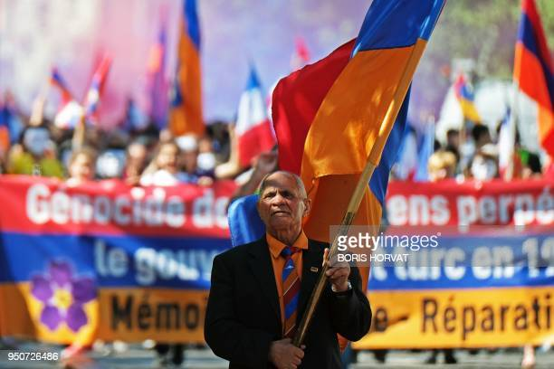 People hold Armenian flags during a march in commemoration of the 103rd anniversary of the mass killings of Armenians by Ottoman forces in 1915 on...