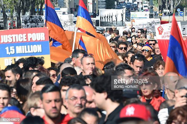 People hold Armenian flags on April 24 2015 in Marseille southeastern France during a commemorative gathering marking the 100th anniversary of the...