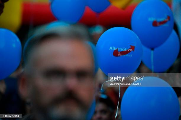 People hold balloons during an election rally of the far-right party Alternative for Germany in Koenigs Wusterhausen, eastern Germany on August 30,...