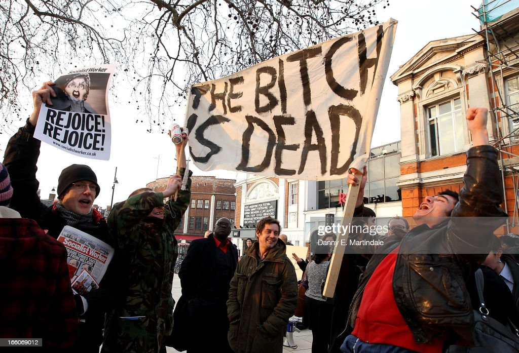 People hold banenrs and signs aloft as they celebrate the death of former British Prime Minister Margaret Thatcher following the announcement of her death in Brixton on April 8, 2013 in London, England. Lady Thatcher has died this morning following a stroke aged 87. Margaret Thatcher was the first female British Prime Minster and governed the UK from 1979 to 1990. She led the UK through some turbulent years and contentious issues including the Falklands War, the miners' strike and the Poll Tax riots.