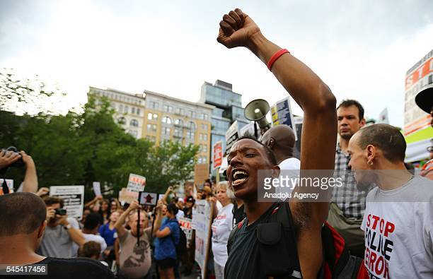 People hold banners and chant slogans as they march from Union Square Park to Grand Central to protest the killing of 3 black men by police in 48...