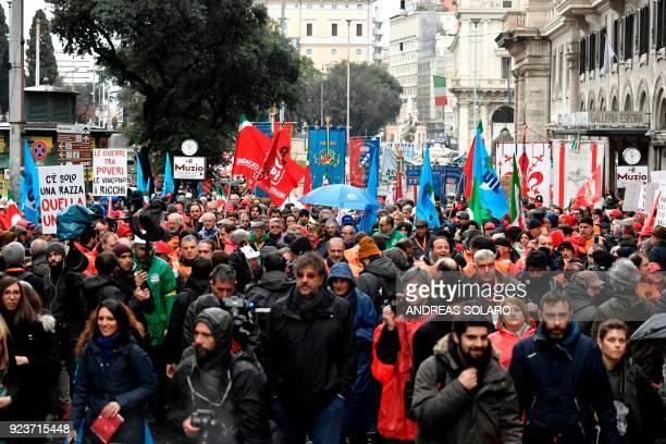 People hold banners and flags as they take part in an antifascist march called by the Italian leftwing parties and organisations in downtown Rome on...