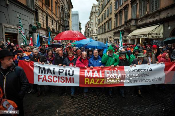 People hold banners and flags during an antifascist march organized by the Italian leftwing parties in Rome Italy on February 24 2018 The Italian...