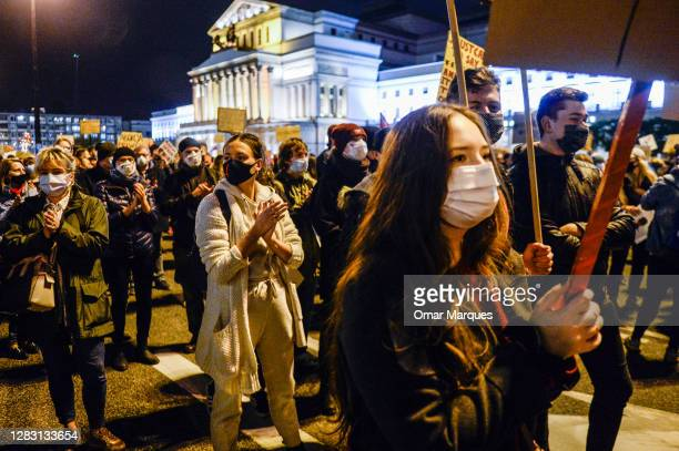 People hold banners and shout slogans as they continue to protest against the Constitutional Court ruling on tightening the abortion law on October...