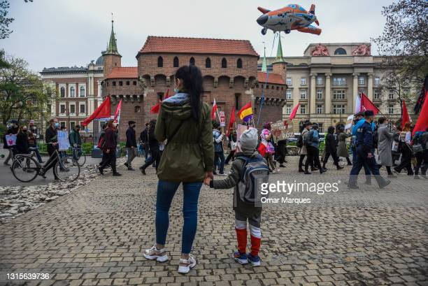 People hold banners and shout slogans during the May Day protest on May 01, 2021 in Krakow, Poland. Every year May Day is used to mark the fight for...