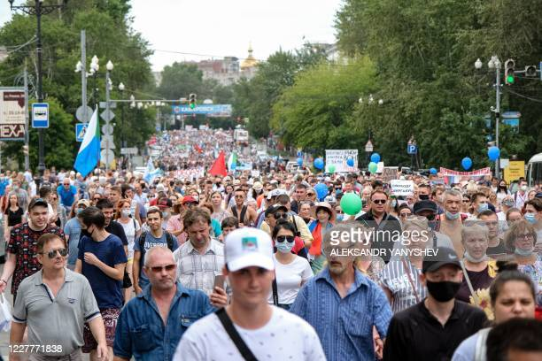 People hold banners and signs during an unauthorised rally in support of Sergei Furgal the governor of the Khabarovsk region who was arrested in the...