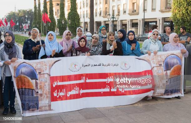 People hold banners as they gather to protest the raids of Jews in Masjid alAqsa in occupied Eastern Jerusalem in front of the Parliamentary building...