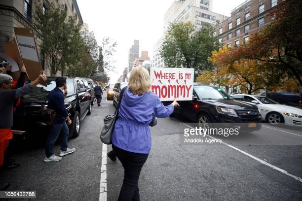 People hold banners as they gather to stage a demonstration against US Homeland Security Secretary Kirstjen Nielsen as she leaves the Council on...