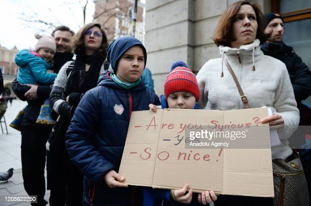 People hold banners as they protest against European Union close borders policy in Krakow, Poland on March 07, 2020. Thousands of refugees and...