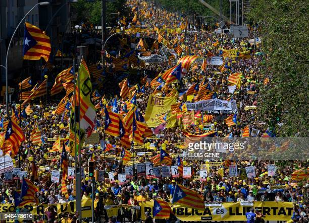 People hold banners demanding freedom and wave Catalan proindependence 'estelada' flags during a demonstration to support Catalan proindependence...