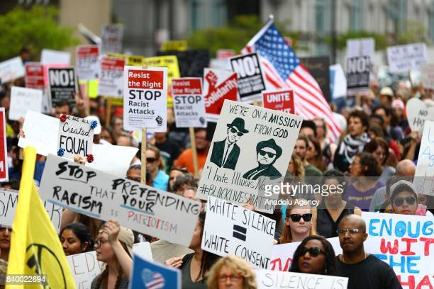 People hold banners during a protest against racism and hate in Chicago United States on August 27 2017 People from different ethnicities and groups...