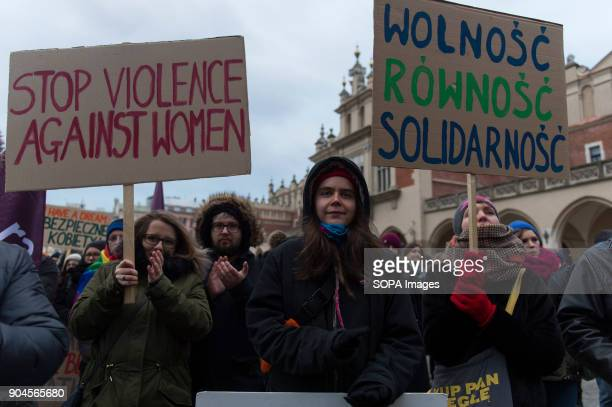 People hold banners during a protest against the rejected civic proposal of law to liberalize abortion and promote sexual education at the Main...