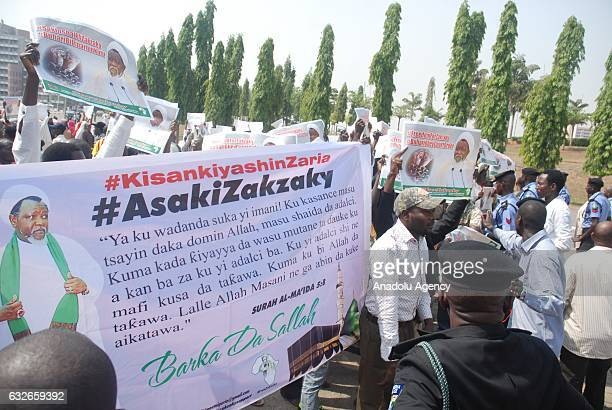 People hold banners during a protest held for The Islamic Movement's leader Sheikh Ibraheem Zakzaky to be released in Abuja Nigeria on January 25 2017