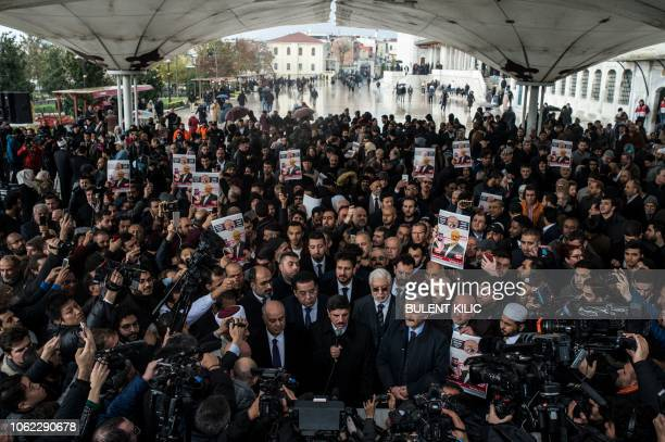 People hold banners during a symbolic funeral prayer for Saudi journalist Jamal Khashoggi, killed and dismembered in the Saudi consulate in Istanbul,...