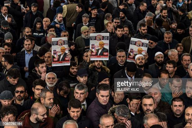 People hold banners of Jamal Khashoggi during a symbolic funeral prayer for the Saudi journalist killed and dismembered in the Saudi consulate in...