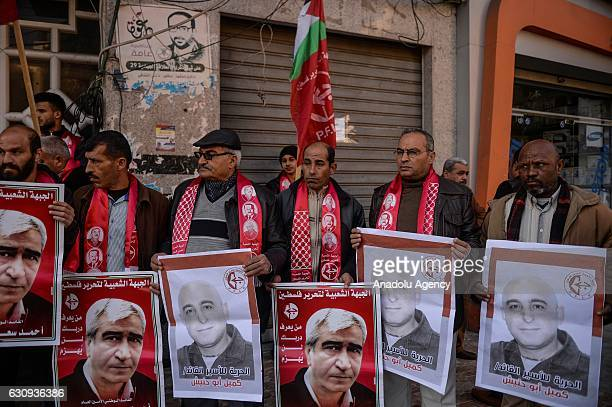 People hold banners of SecretaryGeneral of the Popular Front for the Liberation of Palestine Ahmad Saadat and Kamil Abu Hanish during a demonstration...
