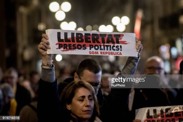 People hold banners reading 'Freedom for political prisoners' during a march in support of imprisoned Catalan independentist leaders in Barcelona...