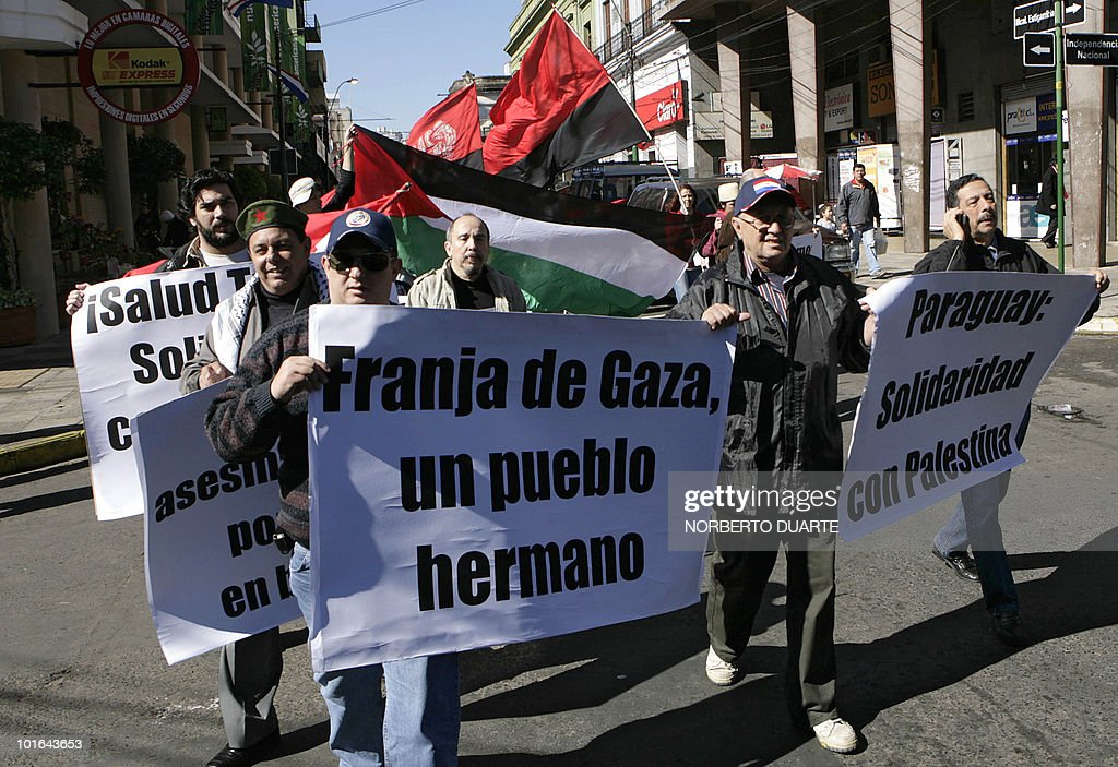 People hold banners reading 'Gaza Strip, our brothers' and 'Paraguay: Solidarity with Palestine' during a demonstration in support of Palestine in Asuncion on June 5, 2010. Earlier this week the Freedom Flotilla, a fleet of ships with international humanitarian aid for the Palestinians in the Gaza Strip, was raided by the Israeli army. Nine activists were killed and several more were injured. AFP PHOTO/Norberto duarte