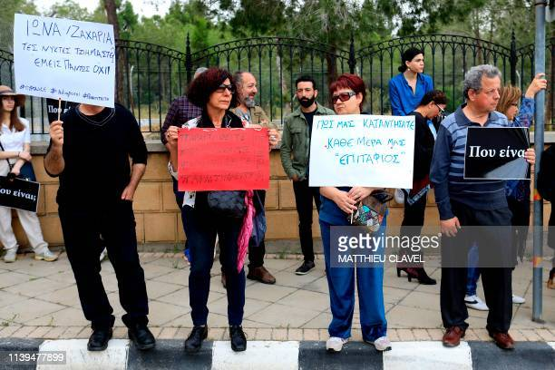 People hold banners reading Where are you and What have you done to us Every day is Epitaph as protesters demonstrate in support of the victims of a...