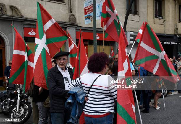 People hold Basques flags as they wait for the start of a demonstration called by the Kalera Kalera Initiative calling for ETA prisonners to be...