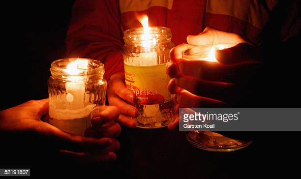 People hold candels in the old marketplace to commemorate victims of WW II on February 13 2005 in Dresden eastern Germany 60 years ago on February...