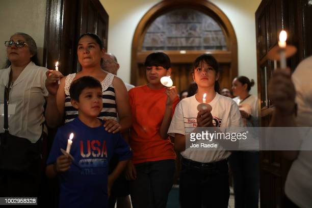 Francisco Mesa joins in with a procession to the St Patrick Cathedral to show their solidarity with migrants on July 20 2018 in El Paso Texas The...