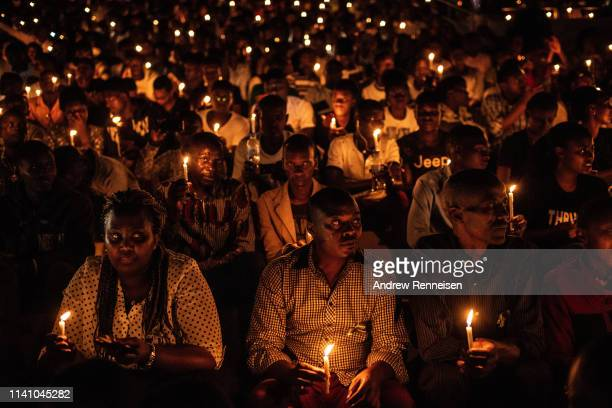 People hold candles during a commemoration ceremony of the 1994 genocide on April 07, 2019 at Amahoro Stadium in Kigali, Rwanda. The country is...
