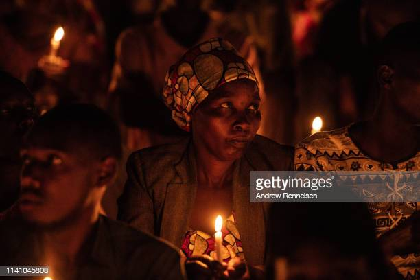 People hold candles during a commemoration ceremony of the 1994 genocide on April 07 2019 at Amahoro Stadium in Kigali Rwanda The country is...