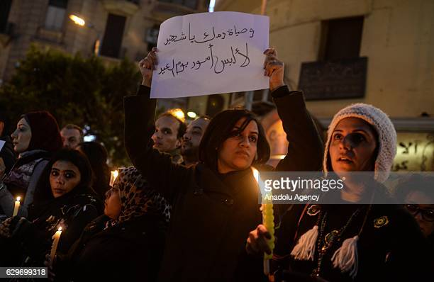 People hold candles during a commemoration for victims of a Sunday bombing at a Coptic cathedral in Cairo Egypt on December 14 2016 Twenty five...