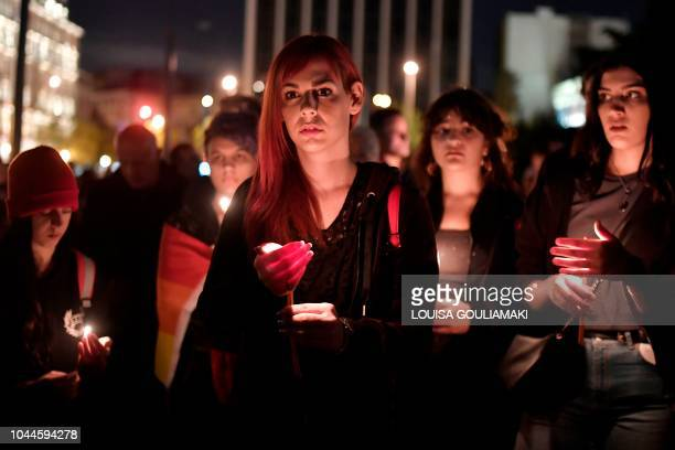 People hold candles during a demonstation in front of the Greek parliament denouncing the death of Zak Kostopoulos a Greek militant homosexual on...